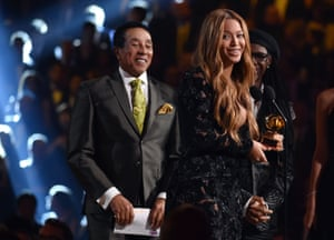 Smokey Robinson, left, presents Beyoncé with the award for best R&B performance for Drunk in Love, which also picked up best R&B song.