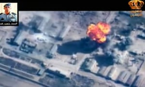 An image grab taken from Jordanian TV said to show flames erupting from a building hit by an air strike against Isis.