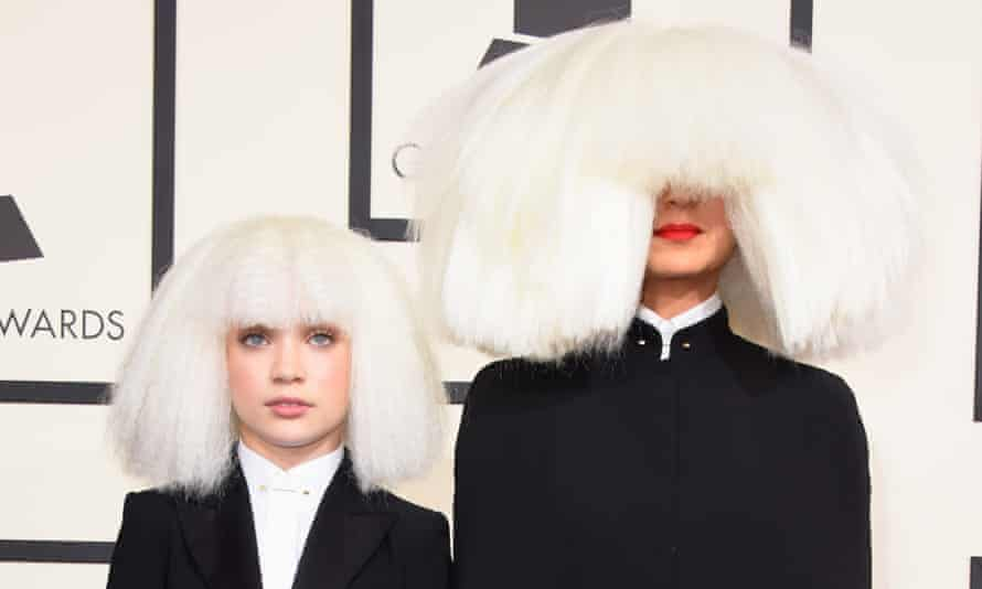 Sia (right) appears with her stand-in, dancer Maddie Ziegler at the 2015 Grammy awards.