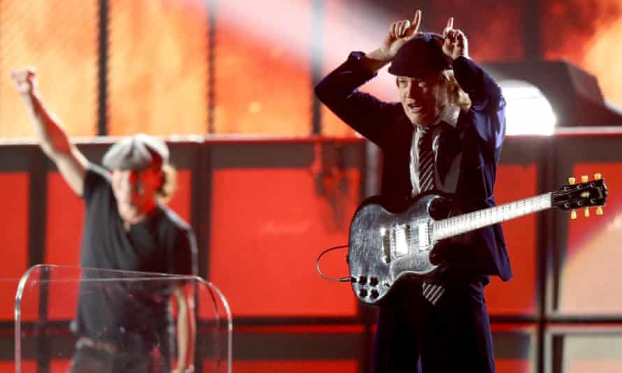 Singer Brian Johnson (left) and guitarist Angus Young of AC/DC perform onstage at the Grammys.