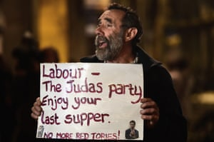 Demonstrators protest outside a Labour fundraiser in Glasgow in October 2014.