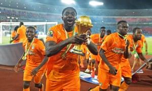 Ivory Coast's Kolo Touré raises the trophy after the final.