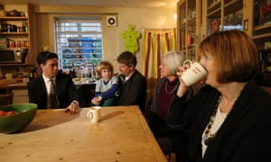 Labour party leader Ed Miliband and MP Harriet Harman (far right) meet Tom Gray with his son Archie and Archie's grandmother Ulla Gray in Peckham