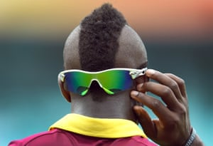 West Indies cricketer Andre Russell adjusts his sunglasses during their one-day international World Cup warm-up match against England at the Sydney Cricket Ground