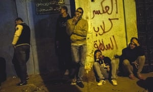 Family and friends of fans killed during the riot wait outside the Zeinhom morgue in Cairo