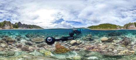 A survey phtoographer filming a reef.