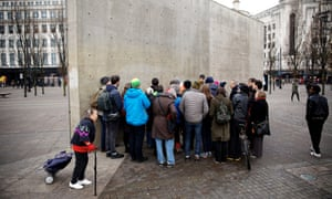 The tour group contemplate Tadao Ando's concrete wall in Manchester's Piccadilly Gardens.