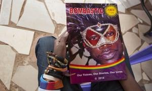 Kasha Jacqueline Nabagesera, a member of the Ugandan lesbian, gay, bisexual, transgender and intersex (LGBTI) community, holds Bombastic, a new magazine published in Kampala.
