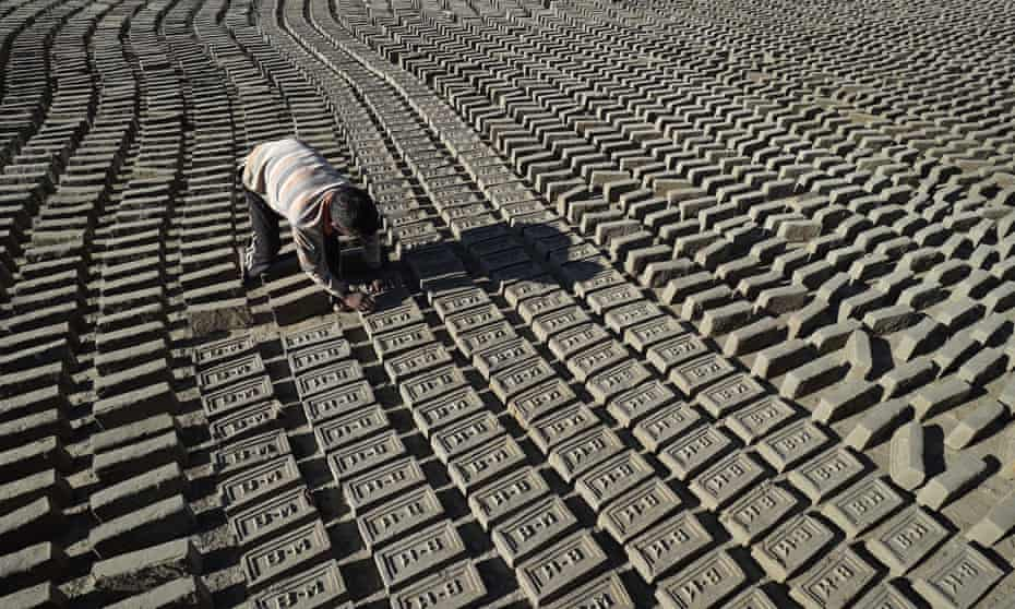 Rajan Magar say he gets up at 1am each day to make bricks at Bhramhayani Mata brick factory, in Bhaktapur, near Kathmandu. Bricks from this factory, or one of its partners, have been used to build a humanitarian staging area for the World Food Programme, with funding from DfID.