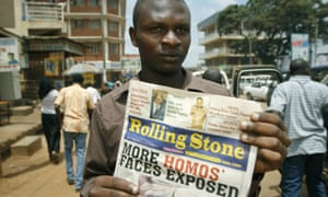 A photo from 2010 shows the managing editor of The Rolling Stone newspaper, which has no relation to the US magazine, Giles Muhame, holding an issue of his publication in Kampala. The issue published the names and photos of 14 men it identified as gay.