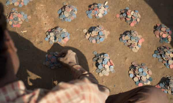 Workers from Bihar, India, count out tokens at the Om Himalayan brick factory near Kathmandu, which record the number of brick loads they have carried.  A small number of bricks from this factory have been used in the construction of a new Fairfield by Marriott hotel in Kathmandu.