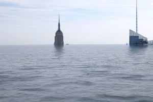 The top of the Empire State Building peeks out from above the water