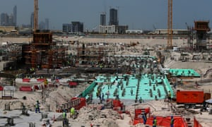 Workers are seen at the site where the Louvre Abu Dhabi is being constructed.
