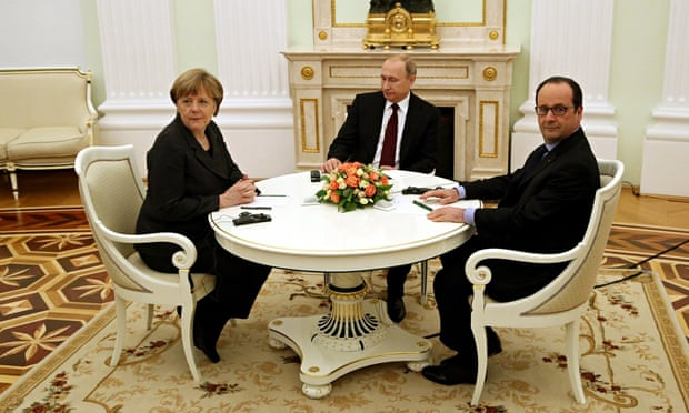 Russia's President Vladimir Putin, centre, with Germany's Chancellor Angela Merkel and France's President Francois Hollande