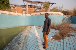 Gbadolite: the private palace of President Mobutu. A relative stands in the disused swimming pool.