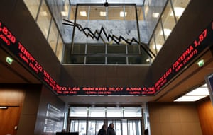 An electronic board displays stock prices at the Athens Stock Exchange reception hall February 9, 2015.