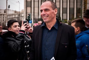 Yanis Varoufakis, Greece's finance minister, was surrounded by students taking pictures of him as he walked to the Greek parliament earlier today.