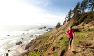 woman running along trail