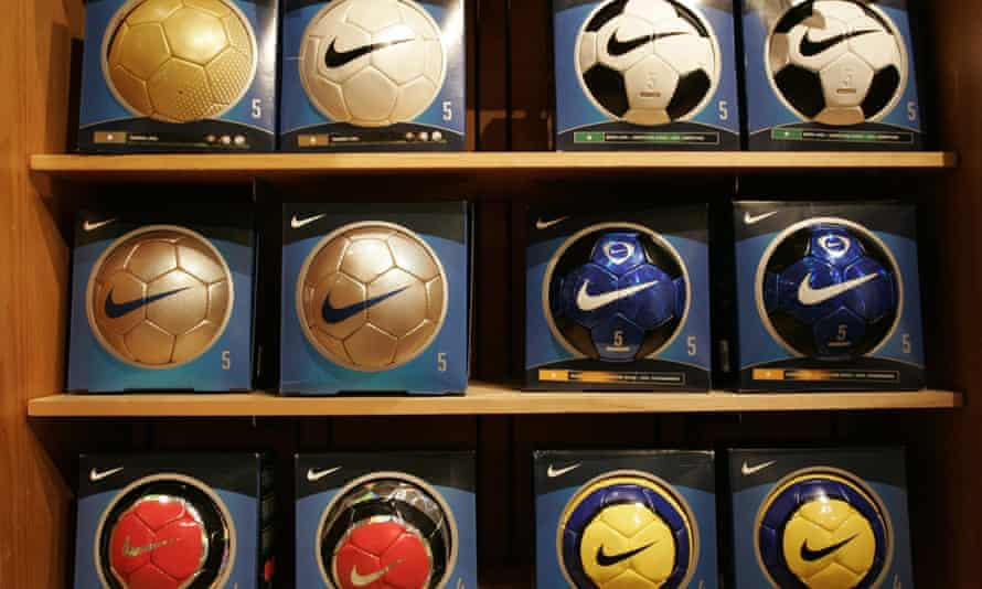 Nike brand soccer balls are on display at a Nike store. A 1996 story exposing child labor in the manufacture of soccer balls put Nike on the defensive.