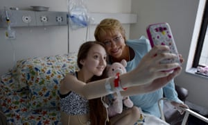 Michelle Bachelet, right, poses for a selfie with Valentina Maureira on Saturday.