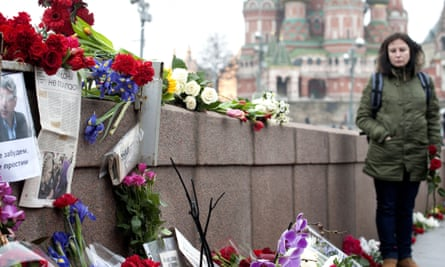 People lay flowers at the place where Boris Nemtsov was killed in Moscow.