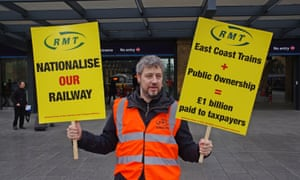 An RMT union member protests at Kings Cross station over the re-privatisation of the East Coast railway.