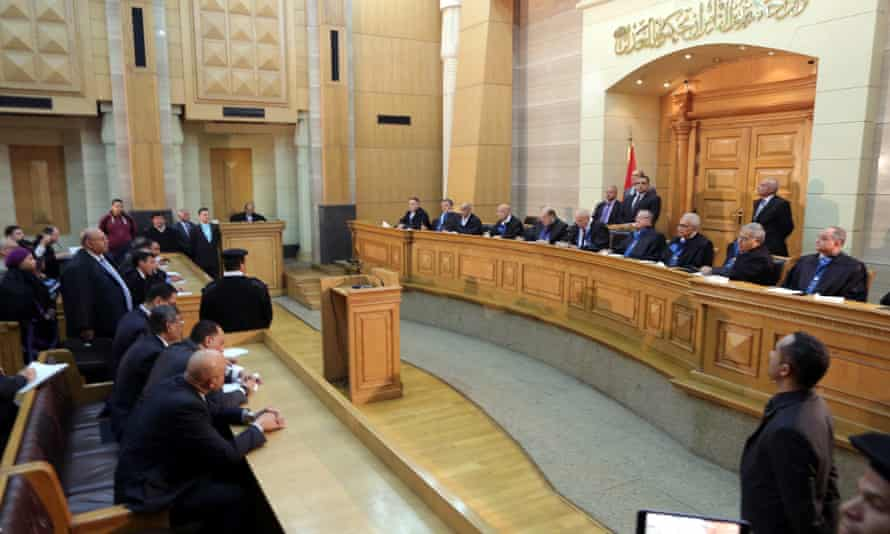 Judges of Egypt's supreme court sit to announce the court's ruling on election legislation, 1 March 2015