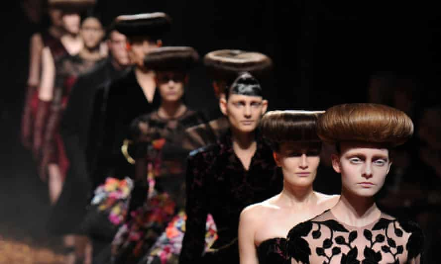 Models present creations during the McQ Alexander McQueen at the London 2012 autumn/winter collection show at London Fashion Week.