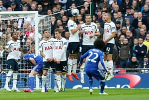 Willian shoots at goal with a free kick as Nacer Chadli and team mates defend in the wall.