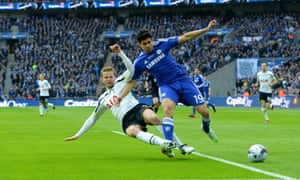 Eric Dier tackles Diego Costa.