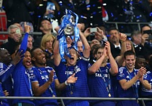 John Terry of Chelsea lifts the Capital One Cup trophy.