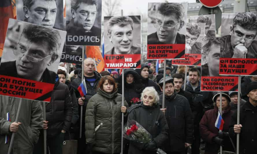 Portraits of Boris Nemtsov are held by marchers in Moscow. Russia
