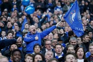 A Chelsea fan beats his heart.