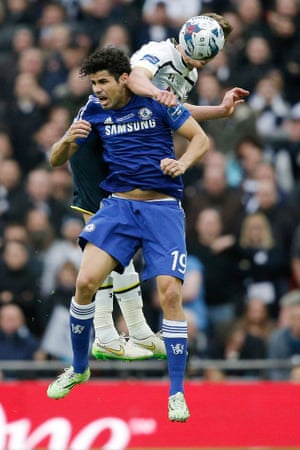 Costa gets an elbow in the ear from Jan Vertonghen in the first half.