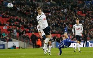 Cesc Fabregas sends an overhead kick past Dier.