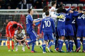 Petr Cech consoles Harry Kane as Chelsea celebrate.