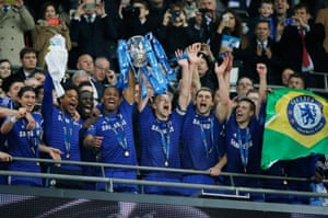 Drogba and Terry lift the trophy.