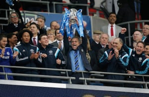 Mourinho lifts the trophy.