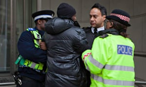 A young black male is arrested by police.