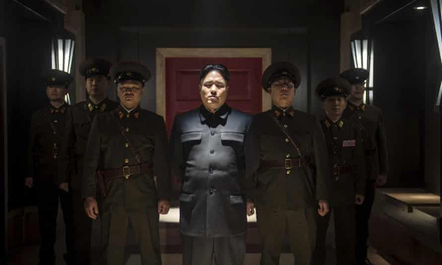 """Actor Randall Park, centre, portrays North Korean leader Kim Jong Un in Columbia Pictures' """"The Interview."""" 10,000 copies of the film are to be sent by balloon across the border."""