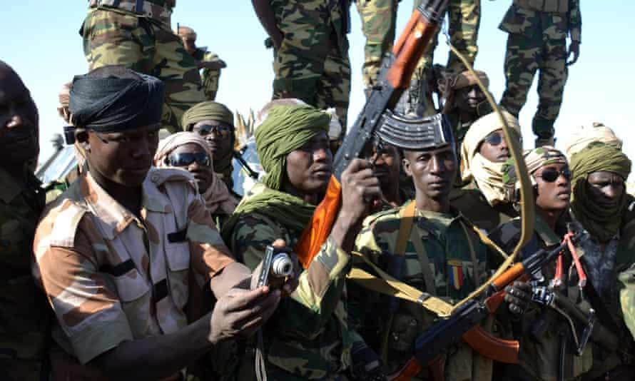Chadian soldiers gather near the Nigerian town of Gamboru.
