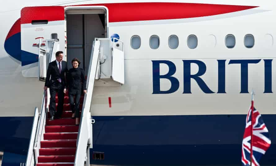 David Cameron and his wife Samantha disembark from a plane at Andrews Air Force Base in Maryland in 2012