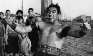 Anthony Quinn as in Fellini's La Strada.
