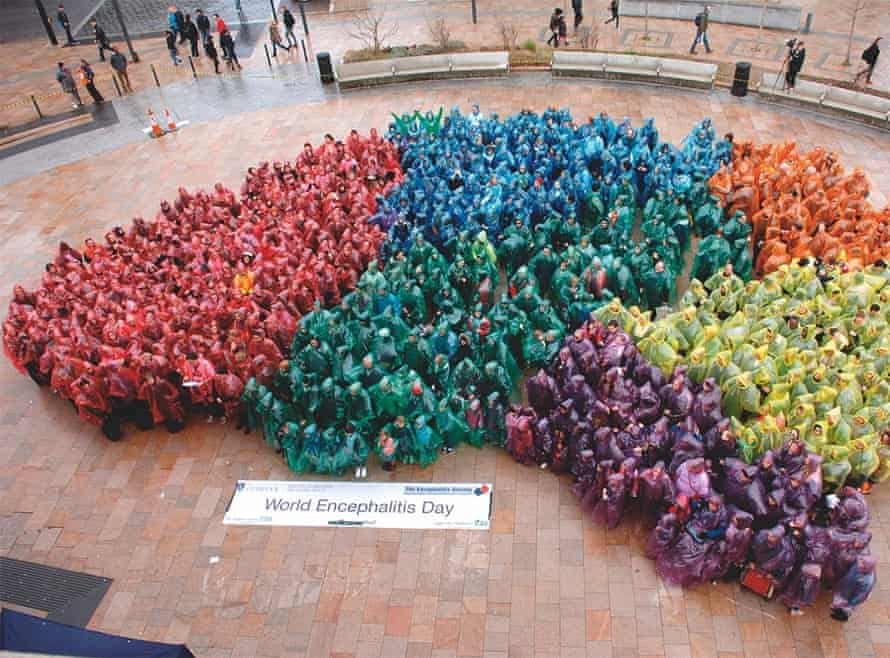 A human brain made up of people in coloured cagoules, organised by Tom Solomon to publicise encephalitis