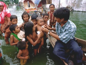 A doctor checks children in Dhaka, Bangladesh