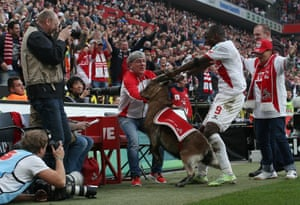 FC Köln's Anthony Ujah celebrates with Hennes after scoring against Eintracht Frankfurt.  The striker subsequently apologised to Hennes for playing a bit too roughly with him