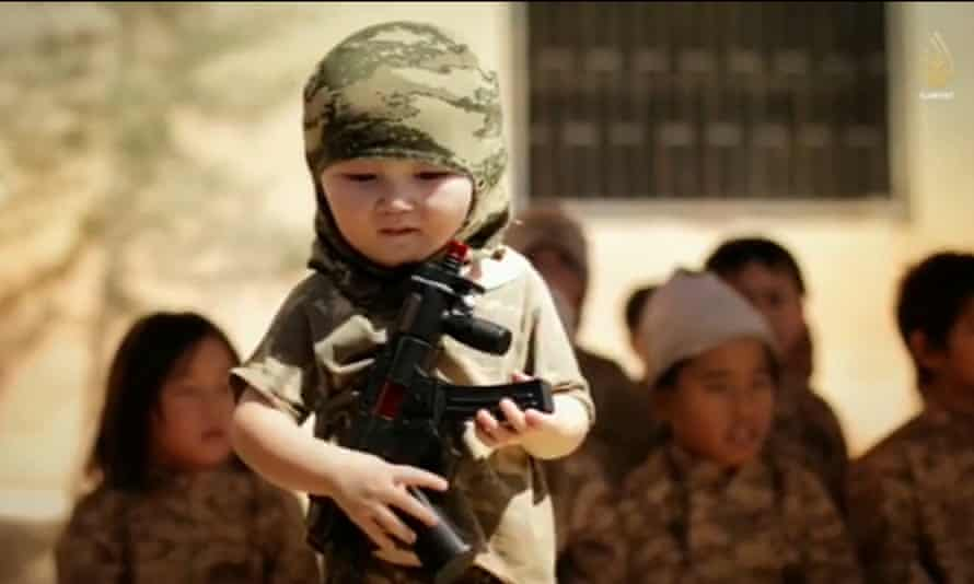 A young child with a toy rifle from a recruitment video.
