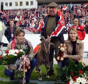Here's Hennes VII with his handler Wilhelm Schäfer and German female footballers Bettina Wiegmann, right, and Sonja Fuss