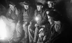 1940s miners take a break down a Welsh slate mine.