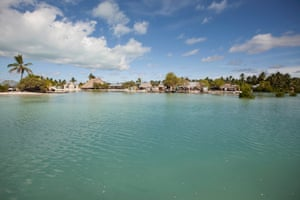 17. High tide completely surrounds Pastor Maerere's village in Eita, South Tarawa. If the seas continue to rise at the current rate, it won't be long before the villagers will have to relocate, as many have already done.
